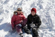 Children playing in snow. At winter vacation Stock Photo