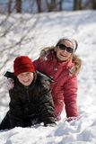 Children playing in snow. At winter vacation Stock Photos
