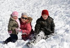 Children playing in snow. At winter vacation Royalty Free Stock Image