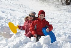 Children playing in snow. At winter vacation Royalty Free Stock Photos