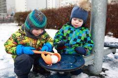 Children playing with snowball maker Stock Photo