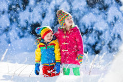 Children playing in snowy winter park Stock Photography