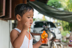 Children playing with soap bubbles, Boy with Bubbles.  Royalty Free Stock Image