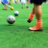 Children playing soccer Stock Image