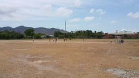 The children are playing soccer on the field in Vietnam. stock photos