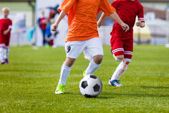 Children playing soccer football match. Running players and kick. Ing soccer ball. Sport school tournament for youth soccer teams Royalty Free Stock Image