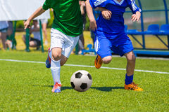 Children Playing Soccer Football Match. Training and football match between youth soccer teams. Young boys playing soccer game. Hard competition between players Royalty Free Stock Images