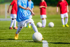 Children Playing Soccer Game on the Professional Football Pitch. Football Soccer Tournament for Youth Teams Royalty Free Stock Images
