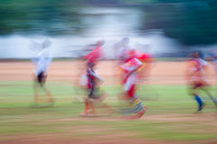 Children playing soccer in india.  Stock Photos