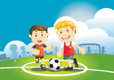 Children playing soccer outdoors. Royalty Free Stock Photo