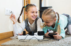 Children playing with sockets and electricity indoors Stock Photos