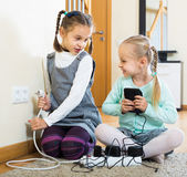 Children playing with sockets and electricity indoors Stock Photography