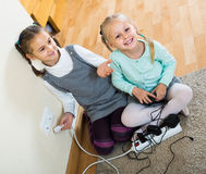 Children playing with sockets and electricity indoors Stock Image