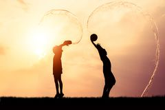 Children playing splash water Songkran silhouette. Children playing splash water on Songkran silhouette stock photos