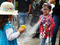 Children playing with spray foam on carnival, Cuenca