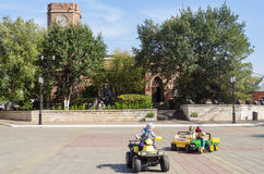 Children playing in the square in front of the Museum of History of Orenburg. Russia Royalty Free Stock Images