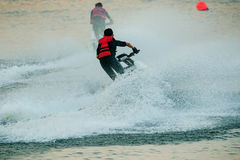 Children playing standing jet ski in fresh water pool use for mo Royalty Free Stock Photos