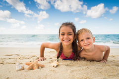 Children playing with a starfish on the beach Stock Photography
