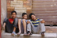 Boys on streets of Giza. Boys sitting on the street in Giza, Egypt Royalty Free Stock Photography