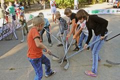 Children playing street hockey on a city holiday in Volgograd stock image
