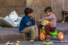Children playing in the street Royalty Free Stock Image