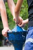 Children playing at a street tap royalty free stock images
