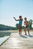 Children playing in summer on a pier Royalty Free Stock Photos