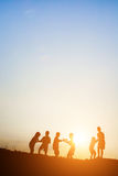 Children playing on summer sunset happy time Royalty Free Stock Image