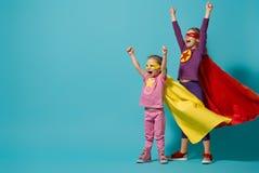 Children playing superhero stock photography
