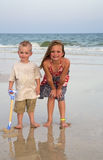 Children playing in the surf on a beach Stock Images