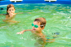 Children playing in the swimming pool Royalty Free Stock Images
