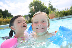 Children playing in swimming pool Royalty Free Stock Image