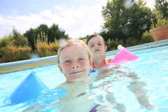 Children playing in swimming pool Stock Images