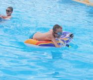 Children playing in the swimming pool. In summer outdoor Stock Photography