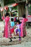 Children Playing Swing Set On Beach Stock Image