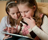Children playing with tablet Stock Photos