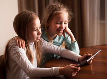 Children playing on tablet Royalty Free Stock Photos