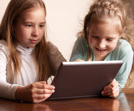 Children playing on tablet Stock Image