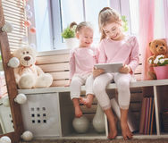 Children are playing with tablet Royalty Free Stock Photos