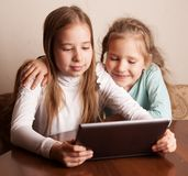 Children playing on tablet stock photos