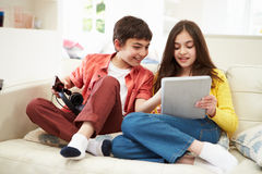 Children Playing With Tablet And MP3 Player Stock Images