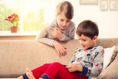 Children playing with tablet pc Royalty Free Stock Photo