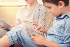 Children playing with tablet pc Stock Image