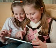 Children playing with tablet Stock Image