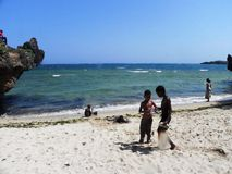 Children playing at  theShore at the Indian Ocean Mombasa. Children playing at  the Shore of  Indian Ocean Mombasa at the East African Coast Stock Photography