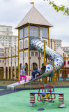 Children playing in a toboggan in a playground in Izvor Park Royalty Free Stock Photography