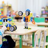 Children playing together at daycare with educational toys indoors. royalty free stock photography