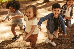 Free Children Playing Together In Forest Stock Photos - 154270103