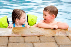 Children playing together in pool Royalty Free Stock Images
