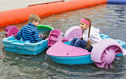 Children playing on toy boats Royalty Free Stock Photography